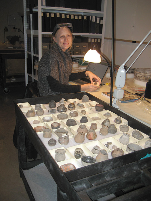 Conservation graduate student intern, Crista Pack, surveys minature pots.